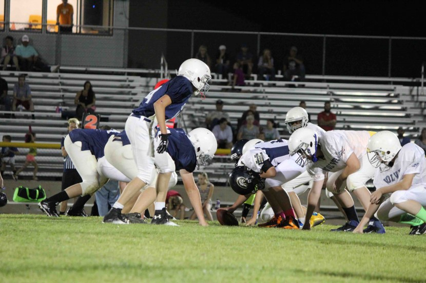 Youth Tackle Football Blue and White Game