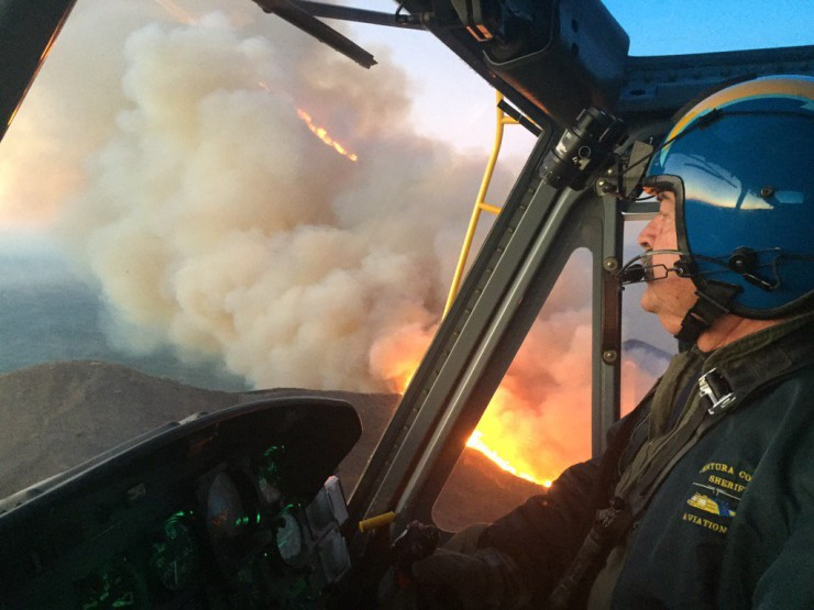 PC: VenturaCoAirUnit Dec 26, 2015 Pilot Jim Dalton & crew, in Copter 7,have been making water drops all night keeping the fire away from houses.