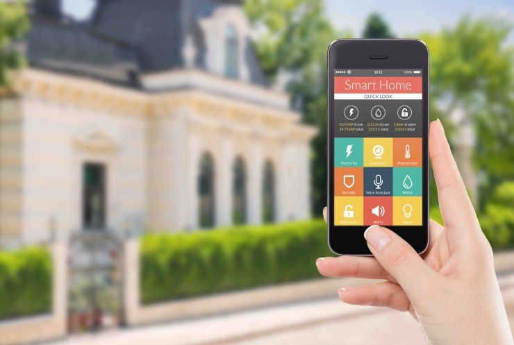 Directly front view of a smartphone with smart home application on the screen in female hand