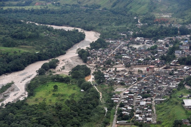 An aerial view shows a flooded area after heavy rains caused several rivers to overflow, pushing sediment and rocks into buildings and roads in Mocoa, Colombia on April 1. Credit: Cesar Carrion/Colombian Presidency/Handout via Reuters